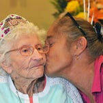 "Barbara Kilgore, a resident at Viera Health & Rehabilitation Center, turned 100 on Wednesday, September 28. There was a party for her with fellow residents, staff, and a musician. Here, she gets a kiss from Debi Johnson, activities assistant, who says "" That's my girl right there. She's my little sweetie"". Barbara will always be the younger sister to Nell Mooney, 102, who lives out of state."