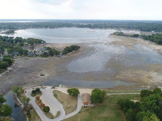 As seen from this aerial photograph, Little Muskego Lake is undergoing a drawdown this year in an effort to remove starry stonewort, an aquatic invasive species. To help protect the lake's fish, the DNR is closing Little Muskego  to fishing from Nov. 1 to March 4.