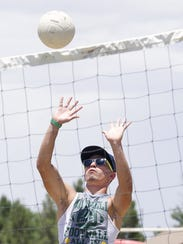 Tommy Montoya gets in a good shot during a volleyball