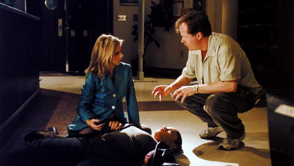 Sarah Michelle Gellar and Joss Whedon on the set of