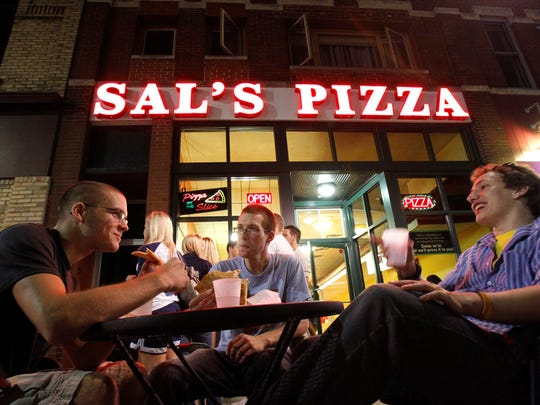 Fox Cities residents enjoy pizza and beverages in front