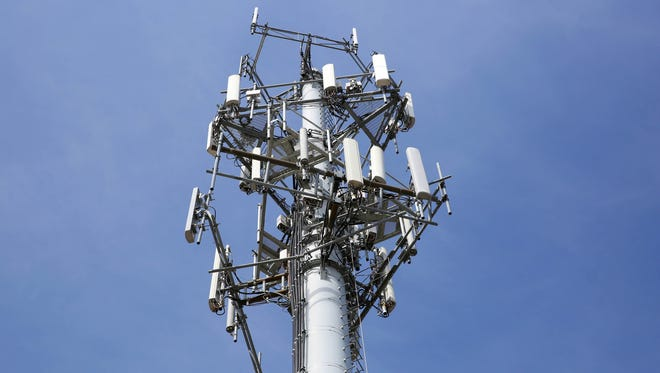 The erection of cellphone tower, such as this one in the Milwaukee area, typically causes concerns among the residents who live nearby. A 2013 state law makes it difficult for communities to deny proposals, however.