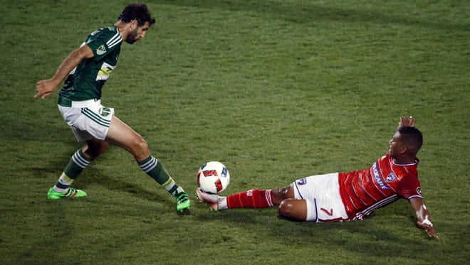 FC Dallas Carlos Gruezo  kicks the ball in front of Portland Timbers Diego Valeri (8) during the the first half of a MLS soccer game, Wednesday, May 11, 2016 in Frisco, Texas. (Nathan Hunsinger/The Dallas Morning News via AP) MANDATORY CREDIT; MAGS OUT; TV OUT; INTERNET USE BY AP MEMBERS ONLY; NO SALES