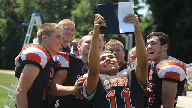 The Lucas Cubs gather for a selfie during a preseason photo shoot. The football team is poising to make a second straight appearance in the Division VII playoffs, standing second in its region as Week 5 approaches.