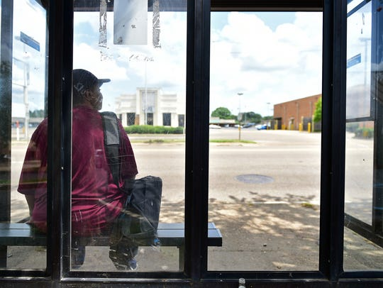 In this June 19, 2016, file photo, Jackson resident Gladys Bunzy sits at a JATRAN bus stop on Robinson Road. The city approved Wednesday, Nov. 14, 2018, a three-year contract with Illinois-based Transdev Services Inc. for the operations and maintenance of Jackson's public transportation system