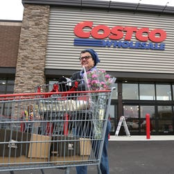 FILE - In this Nov. 12, 2014 file photo, Linda Bultema leaves the Costco store in Kalamazoo, Mich.  (AP Photo/Kalamazoo Gazette - MLive Media Group, Mark Bugnaski, File) ALL LOCAL TELEVISION OUT; LOCAL TELEVISION INTERNET OUT ORG XMIT: MIKAL301
