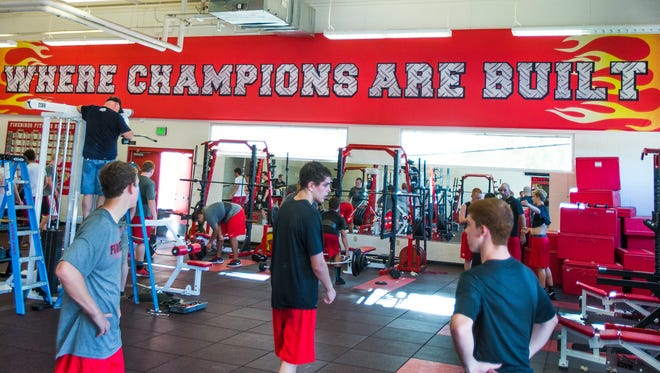 Donations made to the Scottsdale Unified School District have enabled Chaparral High School to create a state of the art fitness center at the school. The football team uses the facility, Wednesday, July 16, 2014.