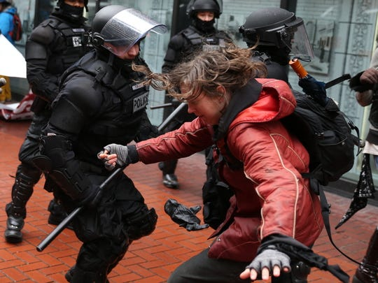 In this Feb. 20, 2017, file photo, protesters clash with police in Portland.