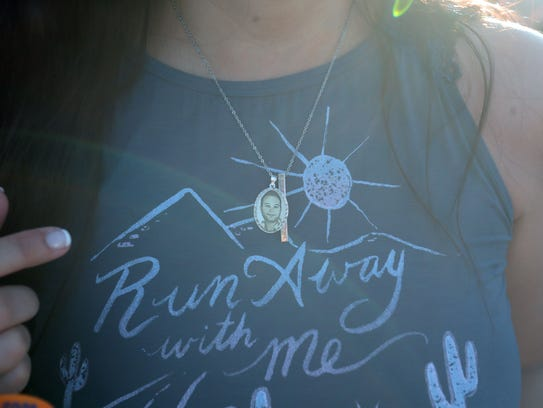 Debby Allen wears a picture of her son Christopher Roybam, who died at the Route 91 Harvest festival mass shooting in Las Vegas, to Stagecoach.