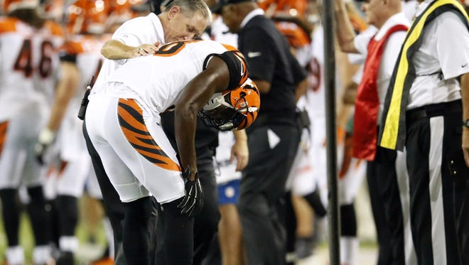 A.J. Green is looked at by trainers on Sunday night in Jacksonville.