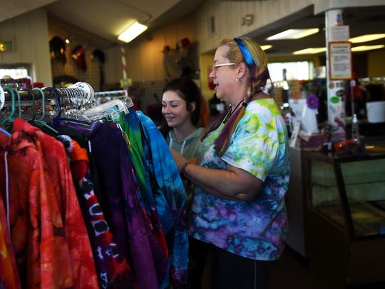 Lauren Hufft, right, owner of Prism Magic Clothing and Imports, sells some tie dye clothes to Michelle McKenzie at her store in Sparks on Jan. 8.