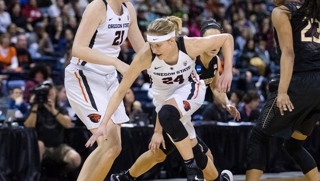 Mar 25, 2017; Stockton, CA, USA; Oregon State guard Sydney Wiese (24) scrambles for a loose ball against Florida State in the first quarter in the semifinals of the Stockton Regional of the women's 2017 NCAA Tournament at Stockton Arena. Mandatory Credit: John Hefti-USA TODAY Sports