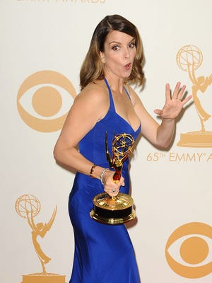 Tina Fey poses in the Emmys press room.