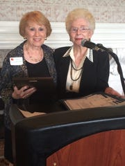 Pres Derhkoop, left, received the Volunteer Award from Vona Klink.