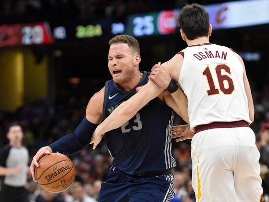 Blake Griffin drives against Cedi Osman in the first quarter Monday.