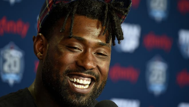 Titans tight end Delanie Walker smiles as he talks about his new contract with the team after practice at Saint Thomas Sports Park Saturday, July 28, 2018, in Nashville, Tenn.