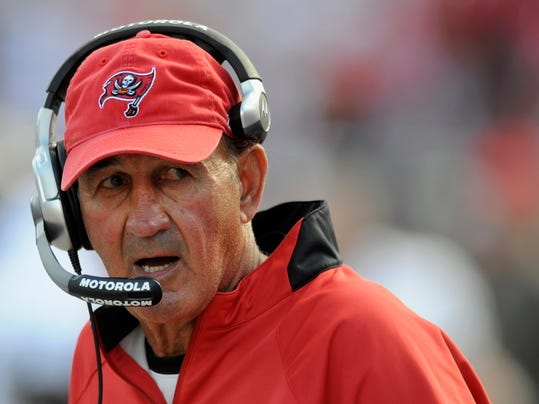 """FILE - In this Jan. 6, 2008, file photo, Tampa Bay Buccaneers defensive coordinator Monte Kiffin looks on during an NFL wildcard football playoff game in Tampa, Fla. These days, the """"Tampa 2"""" defense, directed and perfected by Kiffin under Tony Dungy, is to professional football teams what emailing is for people under 30. It's still playable, but missing much of its prior market share and panache. (AP Photo/Steve Nesius, File)"""
