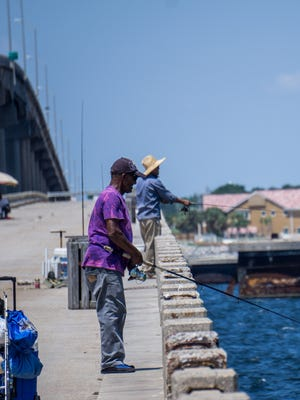 Joseph Hill, 75, spends his day reeling fish in at the Bob Sikes fishing pier.
