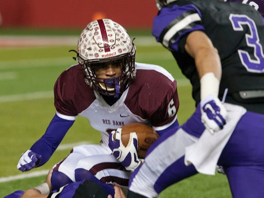 NJSIAA Group 3 state championship football Red Bank Regional vs. Rumson. Red Bank #6 Sadiq Palmer tries unsuccessfully to find a hole in the Rumson line—December 5, 2015-Rutgers, NJ.-Staff photographer/Bob Bielk/Asbury Park Press