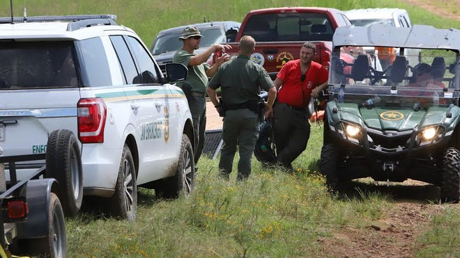 U..S Forest Service and Crawford County Sheriff's Department personnel gather in Chester, Saturday, September 5, near the crash site of a plane. [JAMIE MITCHELL/TIMES RECORD}