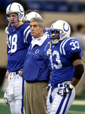 Colts head coach Jim Mora stands with (L to R) quarterback Peyton Manning and running back Dominic Rhodes before the start of the final game of the 2002 season for the Colts and possibly Mora at the RCA Dome Sunday against Denver. The Colts beat Denver 29-10.