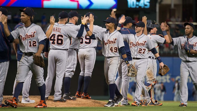 The Detroit Tigers celebrate the win over the Texas Rangers at Globe Life Park in Arlington.