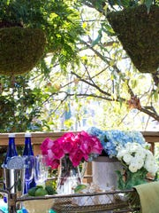 In this photo provided by Brian Patrick Flynn/HGTV.com, for the design of the HGTV.com Spring House outdoor dining deck, the designer Flynn made entertaining easy with a weather-resistant mobile bar cart. Flynn suggests using mobile carts as bars or buffets when space is tight and can't accommodate console tables or sideboards. (AP Photo/HGTV.com, Brian Patrick Flynn)