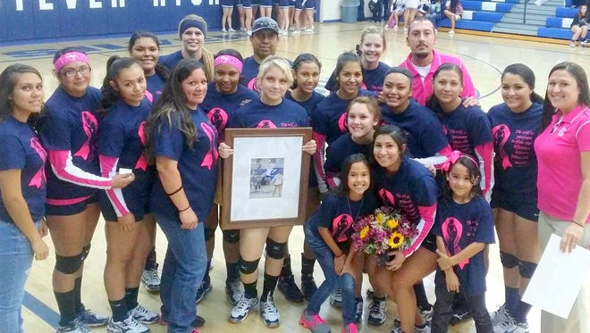 Silver High setter Asia Morales was honored Tuesday night during the pink game against Socorro. The Lady Colts won, 3-0.