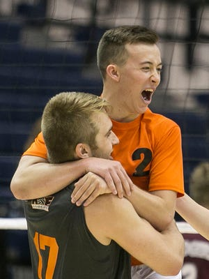 Northeastern's Chris Lee, celebrates with teammate Reese Devilbiss after defeating Ambridge Area High School in the PIAA Boys Volleyball State Championship game at Penn State University Saturday, June 11, 2016. Amanda J. Cain photo