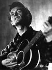 An undated photograph of folk singer Woody Guthrie