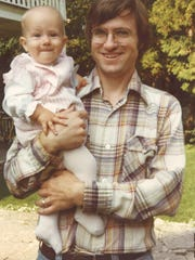 Meredith Coulson was less than a year old and in the arms of her father, White Gull Inn co-owner Andy Coulson, when this photo was taken outside the famed Fish Creek establishment.