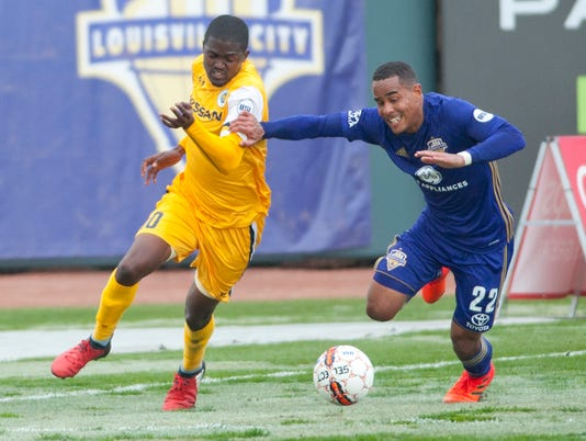 Louisville City's George Davis IV and Nashville SC's Lebo Moloto