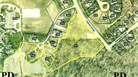 The area within the yellow line is where Walden Co. Ltd. plans to build six single-family condominiums around a street called Equestra Court.