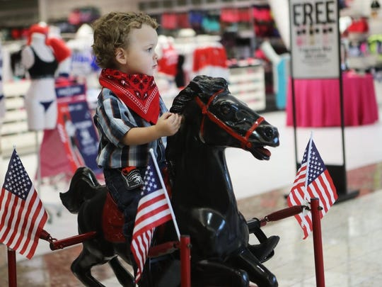 Evan Rhodes, 2, of Redding, sits on his rocking horse in May 2016, waiting for the start of the Asphalt Cowboys' Kiddie Pet Parade at the Mt. Shasta Mall. (Andreas Fuhrmann/Record Searchlight file photo)