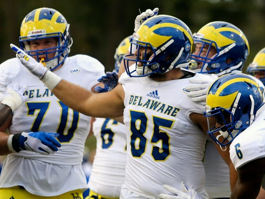 Delaware tight end Charles Scarff celebrates his second quarter reception for a touchdown and a 7-3 lead against Towson at Johnny Unitas Stadium Saturday.