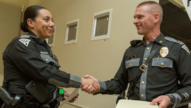 "New Mexico State Police Capt. Stephen Cary awards ""Officer of the Quarter"" to NMSP officer Erika Contreras on Tuesday, May 10, 2016 at the NMSP headquarters located at 4055 Sonoma Ranch Blvd. Contreras has been with an officer with the state police for three years and just joined the Las Cruces office in January."