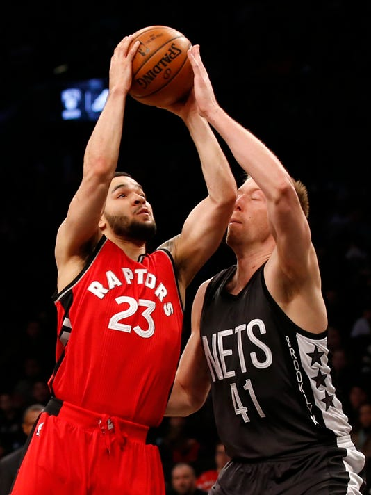 Brooklyn Nets center Justin Hamilton (41) defends against Toronto Raptors guard Fred VanVleet (23) during the first half of an NBA basketball game, Sunday, Feb. 5, 2017, in New York. (AP Photo/Kathy Willens)