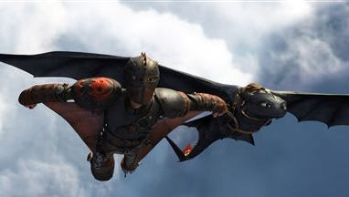 """Hiccup, voiced by Jay Baruchel, and Toothless in a scene from """"How To Train Your Dragon 2."""""""