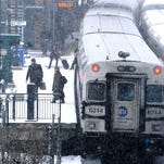Passengers get off a Metro-North commuter train at the Poughkeepsie Train Station in February 2013.