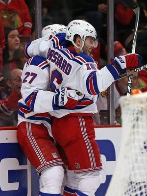 Derick Brassard celebrates his overtime goal Sunday night with Rangers teammate Ryan McDonagh in Chicago.