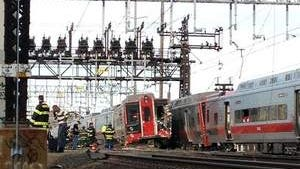 Emergency workers arrive the scene of a train collision, May 17 outside Bridgeport, Conn. A New York-bound train leaving New Haven hit a westbound train that had derailed. Seventy-six people were injured. Some cars on the second train also derailed. / AP Photo/The Connecticut Post, Christian Abraham