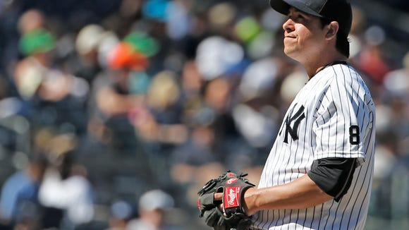 New York Yankees relief pitcher Anthony Swarzak (43) reacts after allowing a two-run home run to Detroit Tigers Ian Kinsler during the seventh inning of a baseball game, Sunday, June 12, 2016, in New York. (AP Photo/Kathy Willens)
