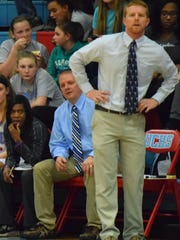 Head Coach Derek Phillips watches game play in the season opener last Tuesday night.