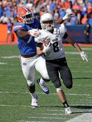 Idaho quarterback Mason Petrino (8) is forced out of bound by Florida defensive lineman Antonneous Clayton Sr. during the second half of an NCAA college football game, Saturday, Nov. 17, 2018, in Gainesville, Fla. (AP Photo/John Raoux)