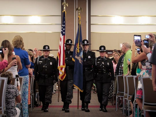 The Michigan Department of Corrections Honor Guard present the colors Friday, August 14, 2015, during the Michigan Department of Corrections commencement ceremony in the Lansing Center.  There were 275 graduates.