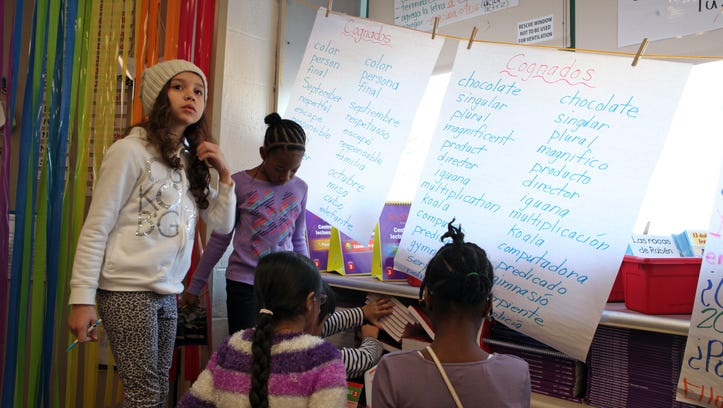 A list of cognate words hangs in the Spanish side of a third-grade English/Spanish bilingual class, Jan. 28, 2014 at Alice E. Grady Elementary School. The bilingual teachers often face a challenge in teaching common core standards since there are few materials available in Spanish.