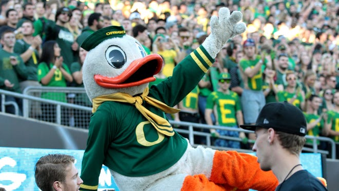Oct 18, 2014; Eugene, OR, USA; Oregon Ducks mascot entertains the fans against the Washington Huskies at Autzen Stadium. Mandatory Credit: Scott Olmos-USA TODAY Sports