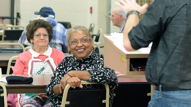 Francisca Cieo of Franklin Township, left, and Guillermina Ortiz of York City listen to Tadd Hoffman, a Family First Health coordinator, during a health presentation for seniors Wednesday at the White Rose Senior Center. Cieo volunteers at the center. Seniors looking for help updating their Medicare plans can get help through the York County Area Agency on Aging's Apprise program.