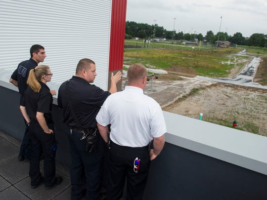 Representatives from various area law enforcement and fire departments look at available routes from the roof during a tour of the new McCutchanville Elementary School on Wednesday, June 27, 2018. The $27 million school will be open at the start of the next school year.