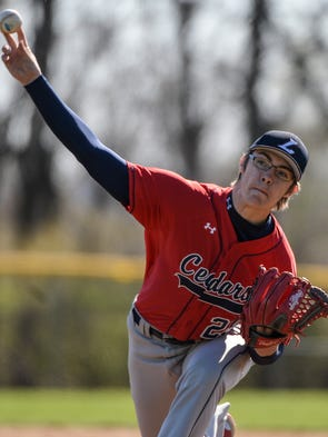 Lebanon's Cody Kissinger delivers a pitch as he threw